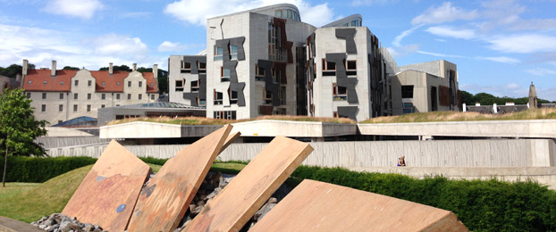 Exterior view of the Scottish Parliament building on a sunny day