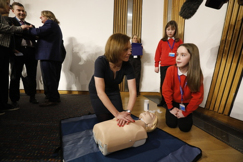 Members of the Public Petitions Committee are given CPR and first aid demonstrations