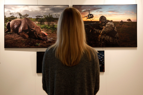 A woman views images during the launch of the World Press Photo 2017 exhibition.