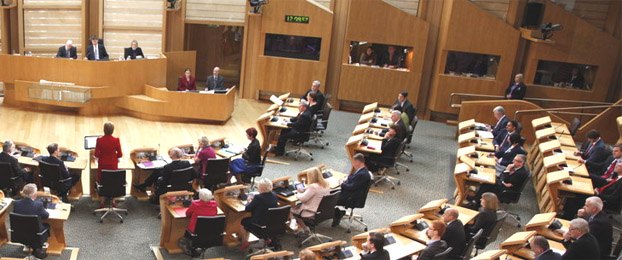 The Scottish Parliament's debating chamber occupied by MSPs during a debate
