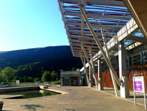 Photograph of the visitor entrance at the front of the Scottish Parliament building taken on a sunny morning in Edinburgh