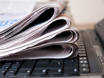 Picture of newspapers on laptop. © Muharrem Oner/iStockphoto