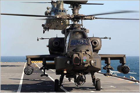 Army Air Corps Apache and RAF Chinook helicopters practise deck landings onboard HMS Illustrious. Picture: Ministry of Defence